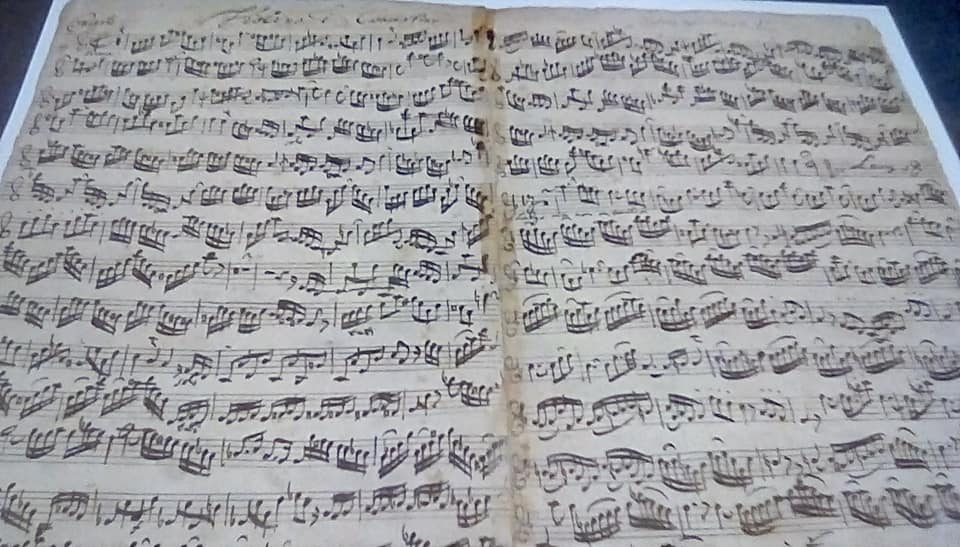 Photo of musical score for Bach's double violin concerto in his own hand
