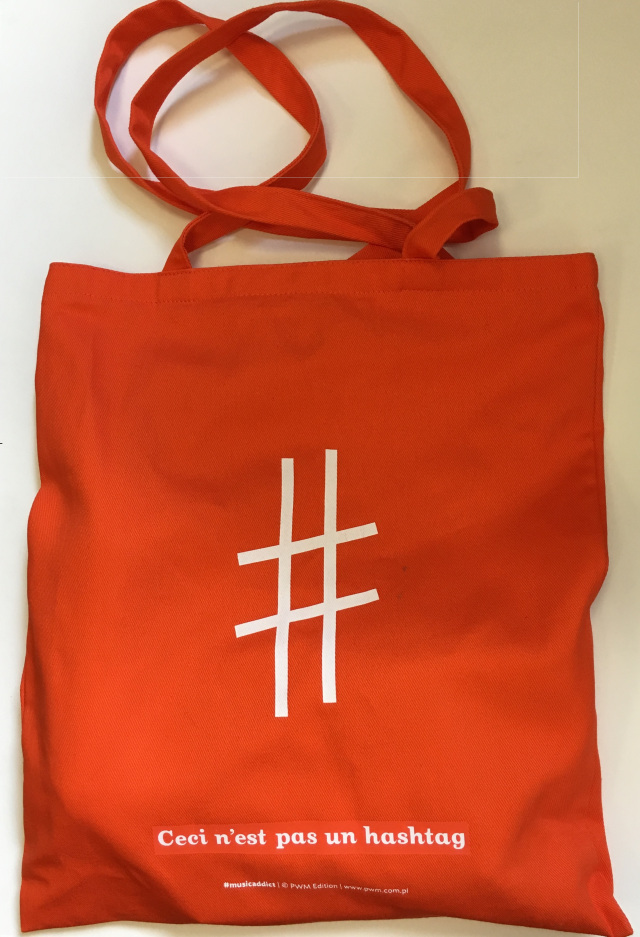 Red tote bag with a musical sharp symbol